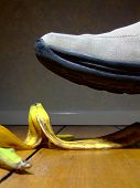 image of slip hazard  - Banana peel lying on the floor and about to be stepped on  - JPG