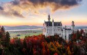 The Famous Neuschwanstein Castle During Sunset, With Colorful Clouds Under Sunlight. Dramatik Pictur poster