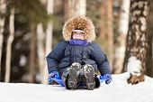 picture of toboggan  - Little smiling child boy sled tobogganing on winter snow hill