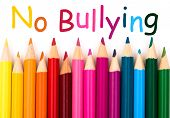 foto of stop bully  - A pencil crayon border isolated on white background with words No Bullying - JPG