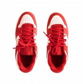 Top View Of Red Gumshoes Or Skate Shoes Isolated On White Background poster