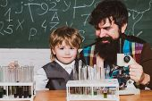 School Chemistry Lessons. Elementary School Kid And Teacher In Classroom At School. Chemistry The Sc poster