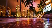 Skyscrapers In Downtown Miami Seen From The River Walk At Night. Southern Florida, Usa poster
