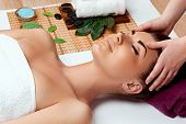 Face Massage. Close-up Of Young Woman Getting Spa Massage Treatment At Beauty Spa Salon.spa Skin And poster