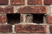 Brick Wall Fragment. Old Dirty Orange And Red Bricks With Defects. Grunge Texture With Cracks And We poster