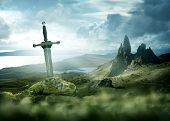 An Ancient And Mythical Sword Set Against A Dramatic Landscape. Fantasy Background 3d Mixed Media. poster