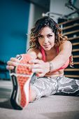 Attractive Muscular Fitness Woman Doing Hard Exercise In Modern Gym poster