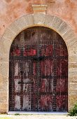 Weathered Old Wooden Gate At Clay Facade In Casbah Of The Udayas In Rabat, Morocco poster