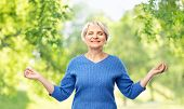 zen, relax and old people concept - portrait of smiling senior woman in blue sweater chilling over g poster
