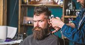 Stylish Haircut Concept. Hands Of Barber With Clipper Close Up. Client With Beard On Salon Backgroun poster