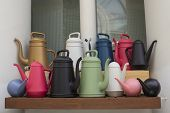 Many Multi-colored Watering Cans For Watering Garden Plants, Moisturizing. Gardening Tools For Water poster