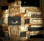 picture of human eye  - Circuit board with Human eye embedded into one of the IC - JPG