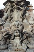 picture of gruesome  - Grotesque mask on the fountain of Piazza della Rotonda in fron of the Pantheon in Rome Italy - JPG