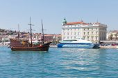 SPLIT, CROATIA - AUGUST 4, 2012: Galley and modern ship in Split harbor on August 4, 2012 in Split,