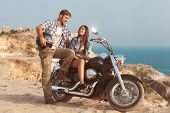 Biker man and girl