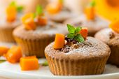 stock photo of patty-cake  - sweet pumpkin muffins with walnuts and powdered sugar - JPG