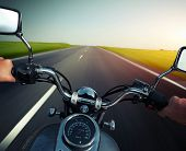 stock photo of pov  - Driver riding motorcycle on an empty asphalt road - JPG