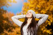 happy woman on a autumn sky background