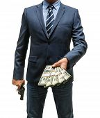 stock photo of delinquency  - studio photography of criminal man with money and gun  - JPG