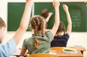 foto of pupils  - School children in classroom at lesson in school - JPG