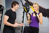 picture of personal assistant  - Personal trainer assist woman exercising on at gym  - JPG