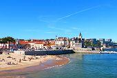 stock photo of sunburn  - Popular Cascais beach near Lisbon in Portugal - JPG