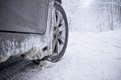 stock photo of arctic landscape  - Winter tire on snow-covered road. Landscape forest