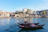 old Porto and traditional boats with wine barrels Portugal
