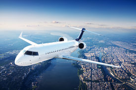 stock photo of panic  - Private jet plane in the blue sky - JPG