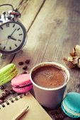 pic of sketch book  - macaroons espresso coffee cup sketch book and alarm clock on wooden rustic table vintage stylized photo - JPG