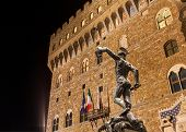 picture of beheaded  - Perseus with the head of Medusa the famous bronze statue in front at the romanesque fortress Palazzo Vecchio the town hall of Florence Italy - JPG