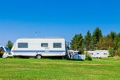 stock photo of trailer park  - Camping life with caravans in nature park - JPG