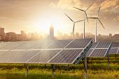 picture of generator  - solar panels and wind generators against city view on sunset - JPG