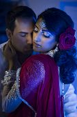 stock photo of ceremonial clothing  - an Indian couple dressed in traditional Indian clothing - JPG
