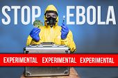 picture of biological hazard  - a man wearing a biological suit holding a petri dish and an experimental drug - JPG