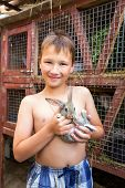 picture of rabbit hutch  - Portrait of boy with little rabbit in his hands - JPG