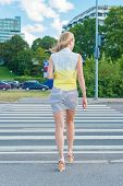 picture of pedestrian crossing  - Woman crossing the road at pedestrian crossing - JPG