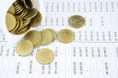 picture of statements  - Gold coin overload in cup place on the statement finance account - JPG