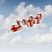 picture of sleigh ride  - Christmas gift sled or santa sleigh concept as Santaclause riding a group of three dimensional presents with holiday silk ribbons as a traditional symbol of winter gift giving and seasonal festive icon for delivering joy to good boys and girls - JPG