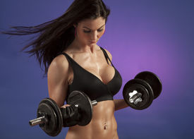 picture of lifting weight  - Studio photo of attractive woman exercising with dumbbell free weights - JPG