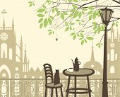 stock photo of kettles  - Outdoor cafe in the old town with a table and a kettle cat spider - JPG