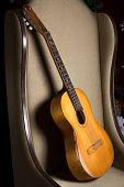 picture of bluegrass  - Acoustic guitar on a chair - JPG