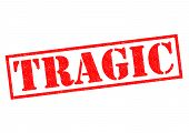 image of tragic  - TRAGIC red Rubber Stamp over a white background - JPG