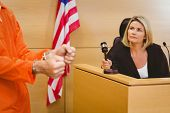 image of court room  - Judge about to bang gavel on sounding block in the court room - JPG