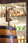 picture of tapping  - Vintage tap to wooden barrel full of beer - JPG