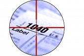 stock photo of irs  - Detail closeup of current tax forms for IRS filing with crosshairs to destroy taxes - JPG