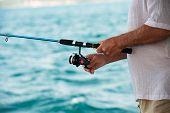 stock photo of fly rod  - Fishing on the sea - JPG