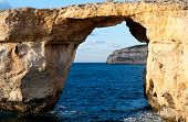 stock photo of gozo  - Azure Window famous stone arch of Gozo island in the sun in the winter Malta - JPG