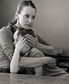 foto of sad boy  - monochrome image of mother holding and comforting her sad little boy, wiping a tear from his face ** Note: Soft Focus at 100%, best at smaller sizes - JPG