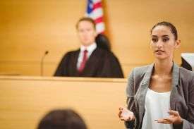 foto of frown  - Serious lawyer make a closing statement in the court room - JPG